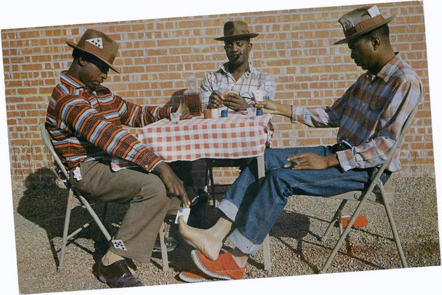 Three black men playing cards outside postcard