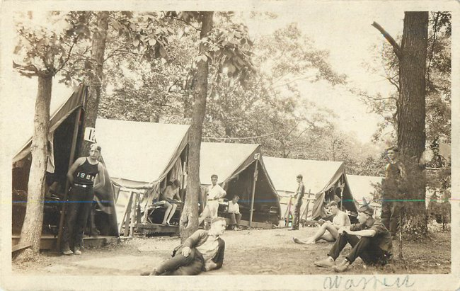 Boyscouts camping in forest