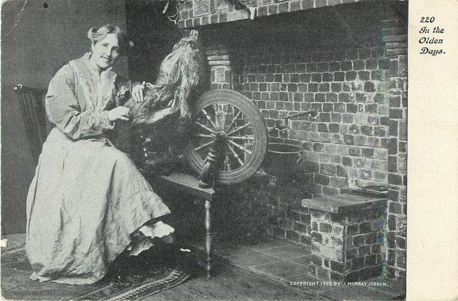 "Woman at spinning wheel by fireplace ""In the olden days"""