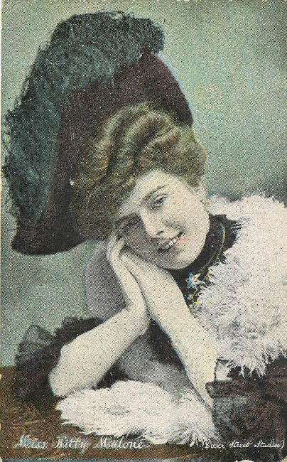 Miss Kitty Malone wearing a Feathered Hat Postcard