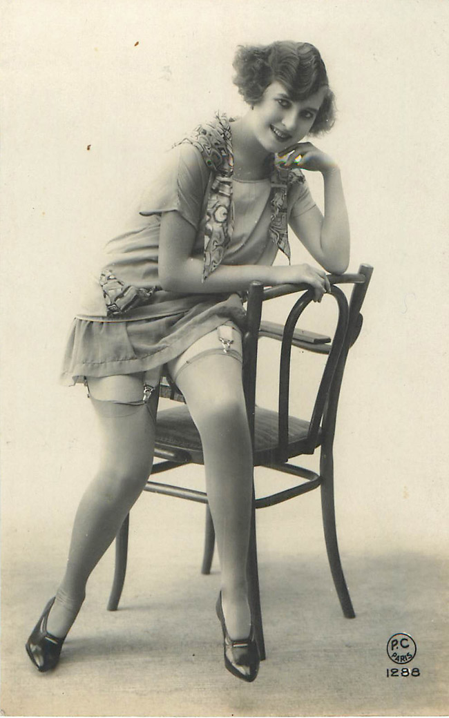 Lady sitting on the edge of the chair - French Risque