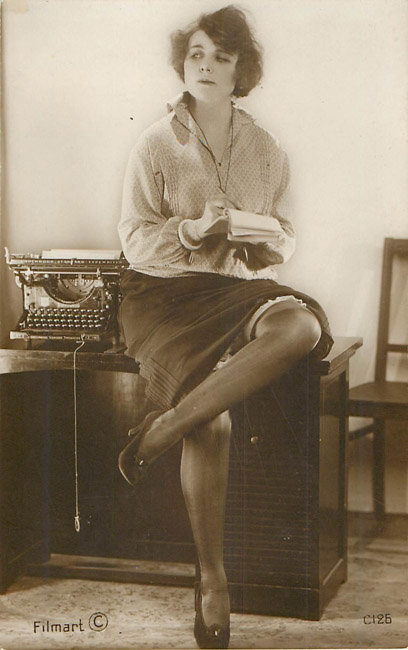Receiptionist sitting on desk with typewriter - French Risque