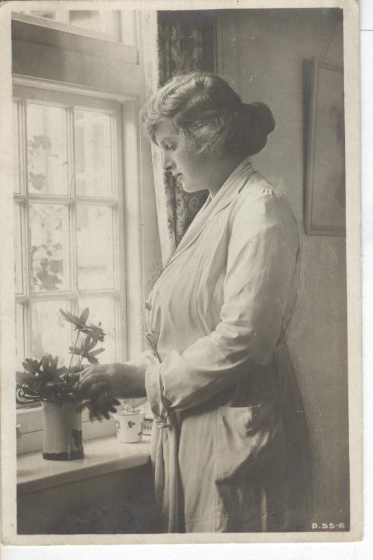 Glamour Girl by Window Tending to Flowers in Vase