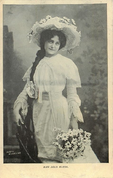 Miss Delia Mason in Hat with Flowers Holding Daisies Postcard