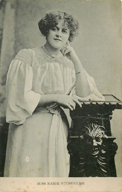 Miss Marie Studholme Leaning on Wooden Pedestal