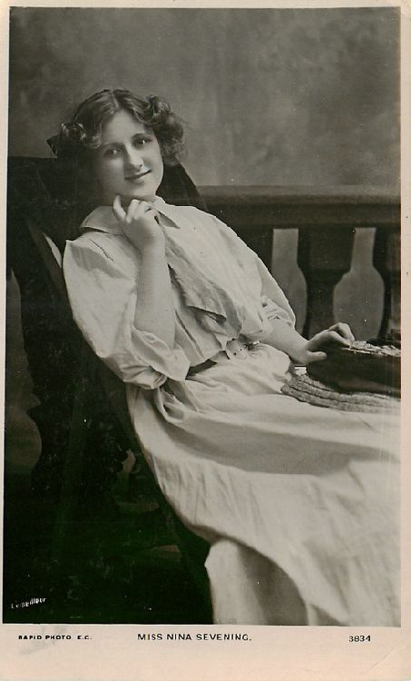 Miss Nina Sevening Sitting in Wooden Bench - No. 3834 Postcard