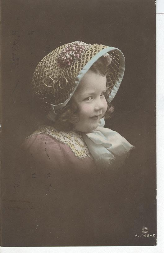 Glamour Child Wearing a weaved bonnett