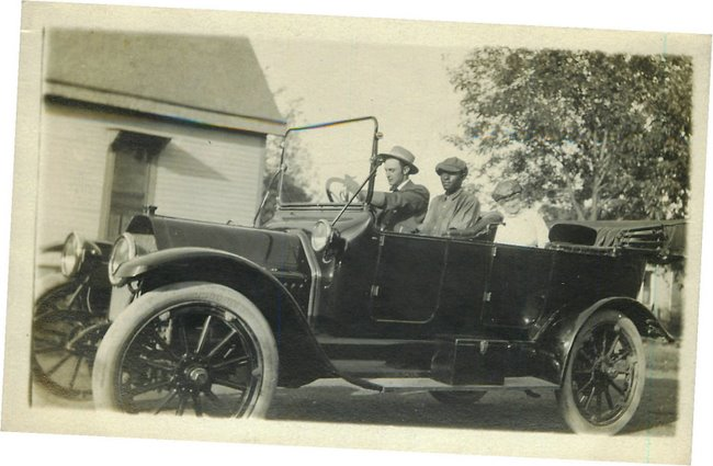 Black Americana Postcard Man escorting lady around in automobile