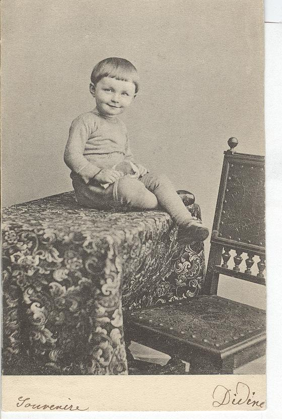 Young Boy Sitting on Table
