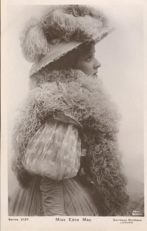 Miss Edna May in a A fancy hat with matching scarf Postcard